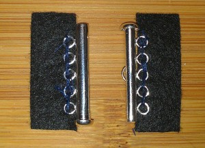 Both pieces of clasp attached to fabric