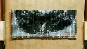 The first quarter of the Sphinx bead tapestry
